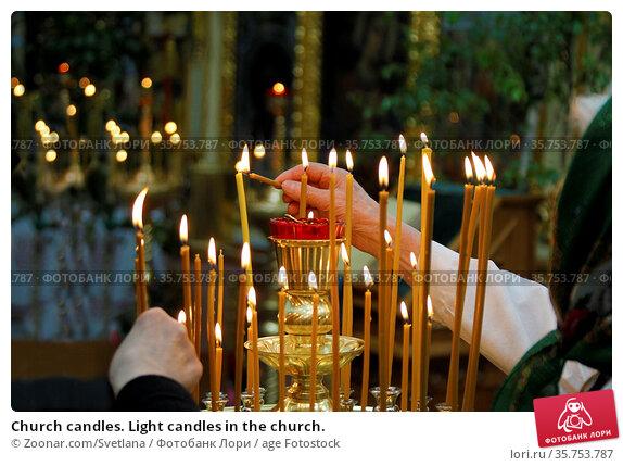 Church candles. Light candles in the church. Стоковое фото, фотограф Zoonar.com/Svetlana / age Fotostock / Фотобанк Лори
