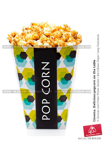 Cinema. Delicious popcorn on the table. Стоковое фото, фотограф Zoonar.com/Yeko Photo Studio / easy Fotostock / Фотобанк Лори
