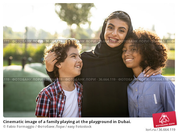 Cinematic image of a family playing at the playground in Dubai. Стоковое фото, фотограф Fabio Formaggio / easy Fotostock / Фотобанк Лори