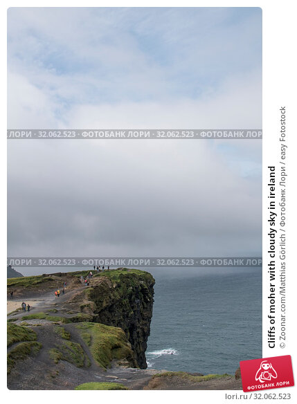 Cliffs of moher with cloudy sky in ireland. Стоковое фото, фотограф Zoonar.com/Matthias Görlich / easy Fotostock / Фотобанк Лори