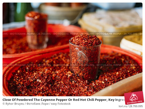 Купить «Close Of Powdered The Cayenne Pepper Or Red Hot Chili Pepper, Key Ingredient And Popular Spice In Variety Of Cuisines. On Sale At The East Market, Bazaar In Glass And In The Tray.», фото № 28700095, снято 28 мая 2016 г. (c) easy Fotostock / Фотобанк Лори