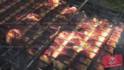 Купить «Close-up - Golden Tasty Sausages Are Grilled On A Grill», видеоролик № 30196523, снято 2 октября 2018 г. (c) Pavel Biryukov / Фотобанк Лори
