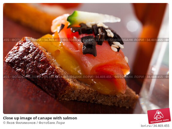 Close up image of canape with salmon. Стоковое фото, фотограф Яков Филимонов / Фотобанк Лори