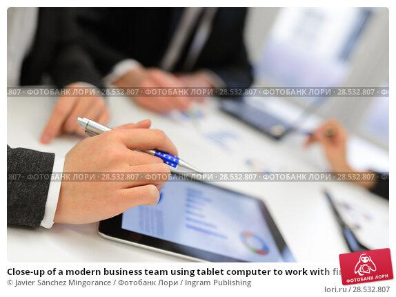 Купить «Close-up of a modern business team using tablet computer to work with financial data», фото № 28532807, снято 14 января 2014 г. (c) Ingram Publishing / Фотобанк Лори