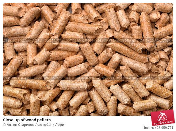 Купить «Close up of wood pellets», фото № 26959771, снято 15 февраля 2016 г. (c) Антон Стариков / Фотобанк Лори