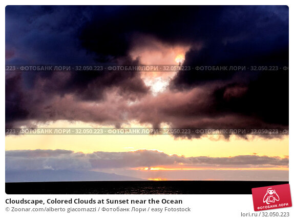 Cloudscape, Colored Clouds at Sunset near the Ocean. Стоковое фото, фотограф Zoonar.com/alberto giacomazzi / easy Fotostock / Фотобанк Лори