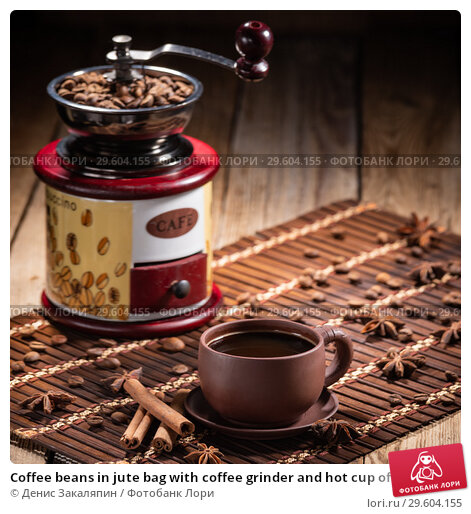 Купить «Coffee beans in jute bag with coffee grinder and hot cup of coffee on wooden table», фото № 29604155, снято 20 апреля 2019 г. (c) Денис Закаляпин / Фотобанк Лори