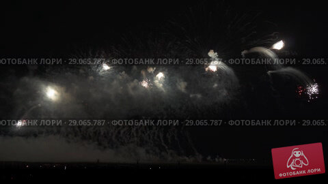 Купить «Colorful fireworks on black sky background stock footage video», видеоролик № 29065787, снято 3 сентября 2018 г. (c) Юлия Машкова / Фотобанк Лори