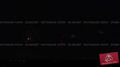 Купить «Colorful fireworks on black sky background stock footage video», видеоролик № 29069887, снято 3 сентября 2018 г. (c) Юлия Машкова / Фотобанк Лори