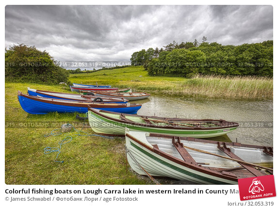 Colorful fishing boats on Lough Carra lake in western Ireland in County Mayo Ireland. Стоковое фото, фотограф James Schwabel / age Fotostock / Фотобанк Лори