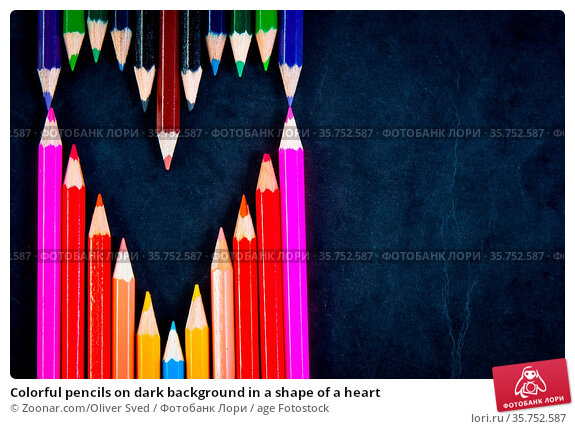 Colorful pencils on dark background in a shape of a heart. Стоковое фото, фотограф Zoonar.com/Oliver Sved / age Fotostock / Фотобанк Лори