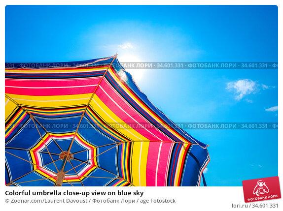 Colorful umbrella close-up view on blue sky. Стоковое фото, фотограф Zoonar.com/Laurent Davoust / age Fotostock / Фотобанк Лори