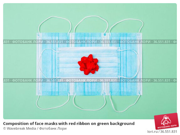 Composition of face masks with red ribbon on green background. Стоковое фото, агентство Wavebreak Media / Фотобанк Лори