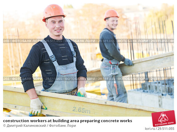 Купить «construction workers at building area preparing concrete works», фото № 29511055, снято 12 октября 2018 г. (c) Дмитрий Калиновский / Фотобанк Лори