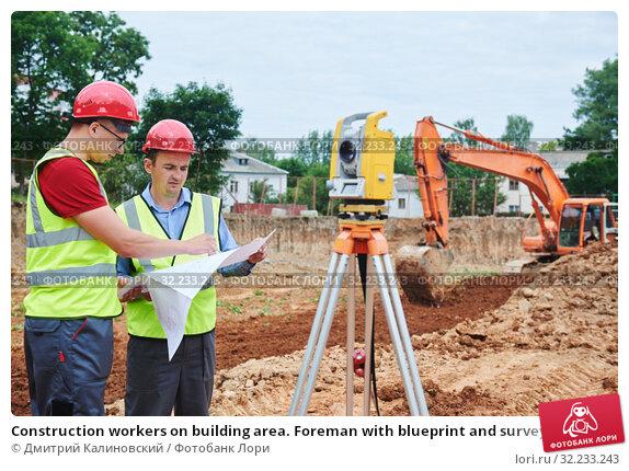 Купить «Construction workers on building area. Foreman with blueprint and surveyoor», фото № 32233243, снято 21 июня 2018 г. (c) Дмитрий Калиновский / Фотобанк Лори