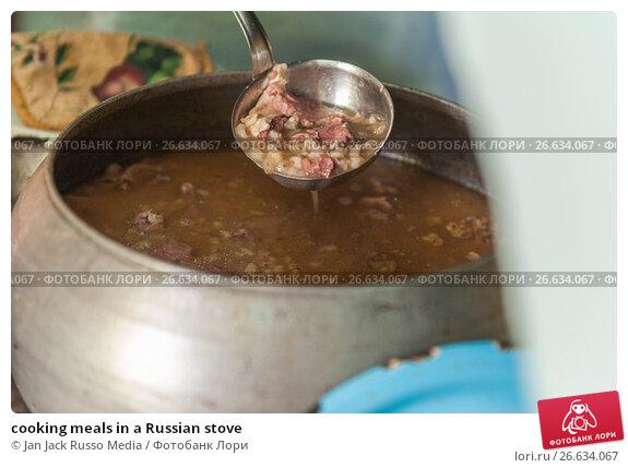 Купить «cooking meals in a Russian stove», фото № 26634067, снято 17 сентября 2016 г. (c) Jan Jack Russo Media / Фотобанк Лори