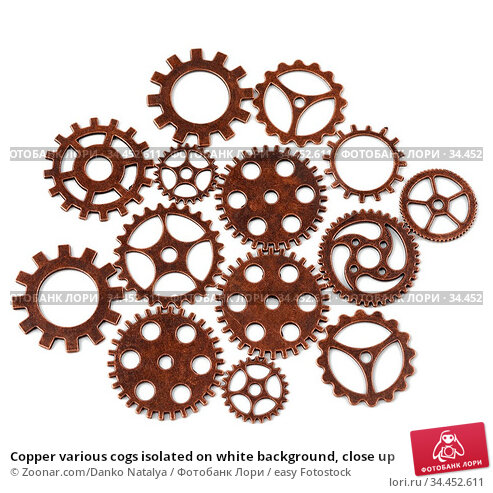 Copper various cogs isolated on white background, close up. Стоковое фото, фотограф Zoonar.com/Danko Natalya / easy Fotostock / Фотобанк Лори
