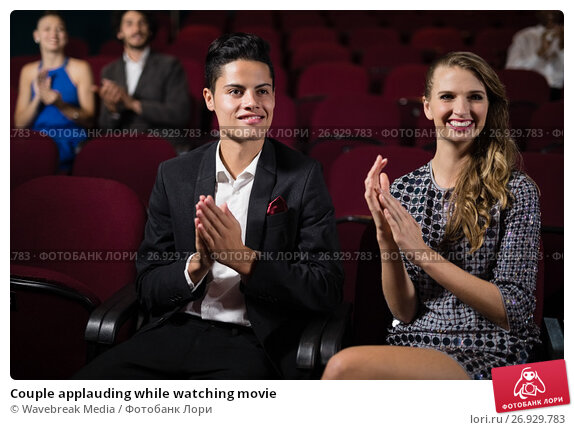 Купить «Couple applauding while watching movie», фото № 26929783, снято 20 апреля 2017 г. (c) Wavebreak Media / Фотобанк Лори