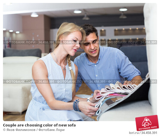 Couple are choosing color of new sofa. Стоковое фото, фотограф Яков Филимонов / Фотобанк Лори