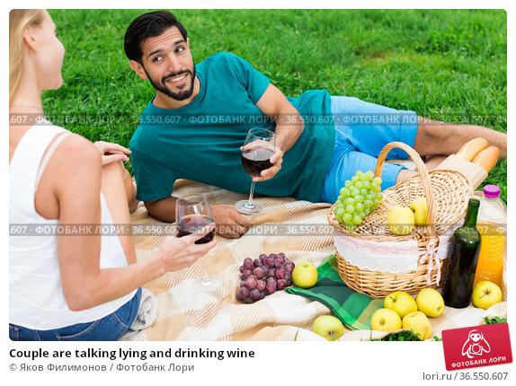 Couple are talking lying and drinking wine. Стоковое фото, фотограф Яков Филимонов / Фотобанк Лори