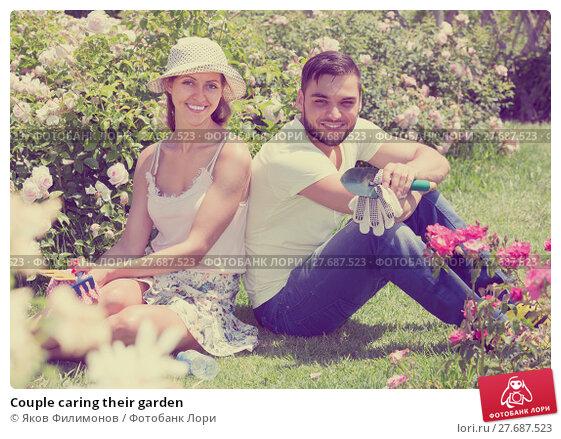 Купить «Couple caring their garden», фото № 27687523, снято 13 ноября 2019 г. (c) Яков Филимонов / Фотобанк Лори