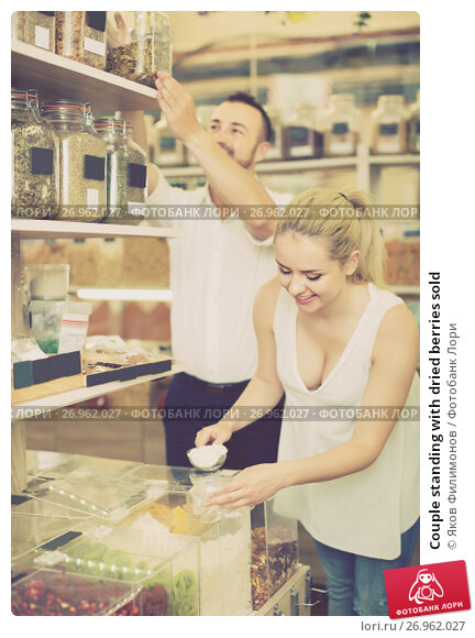 Couple standing with dried berries sold, фото № 26962027, снято 20 октября 2017 г. (c) Яков Филимонов / Фотобанк Лори