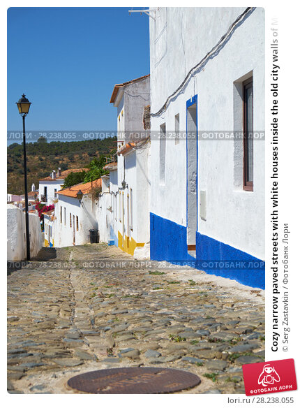 Купить «Cozy narrow paved streets with white houses inside the old city walls of Mertola. Beja. Portugal», фото № 28238055, снято 30 июня 2016 г. (c) Serg Zastavkin / Фотобанк Лори