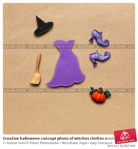 Creative halloween concept photo of witches clothes made of paper on brown background. Стоковое фото, фотограф Zoonar.com/© Fisher Photostudio / easy Fotostock / Фотобанк Лори