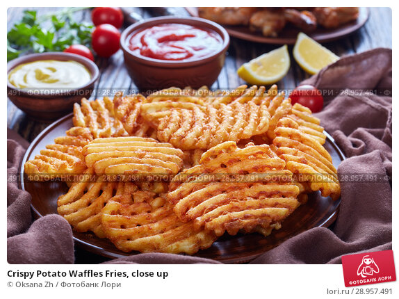 Купить «Crispy Potato Waffles Fries, close up», фото № 28957491, снято 31 июля 2018 г. (c) Oksana Zh / Фотобанк Лори