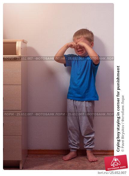 Купить «Crying boy staying in corner for punishment», фото № 25652007, снято 20 июля 2019 г. (c) Pavel Biryukov / Фотобанк Лори