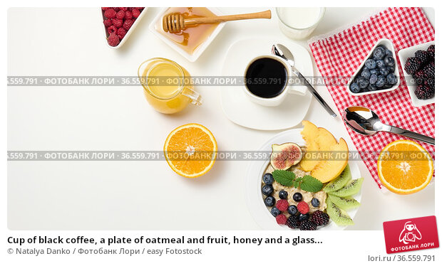 Cup of black coffee, a plate of oatmeal and fruit, honey and a glass... Стоковое фото, фотограф Natalya Danko / easy Fotostock / Фотобанк Лори