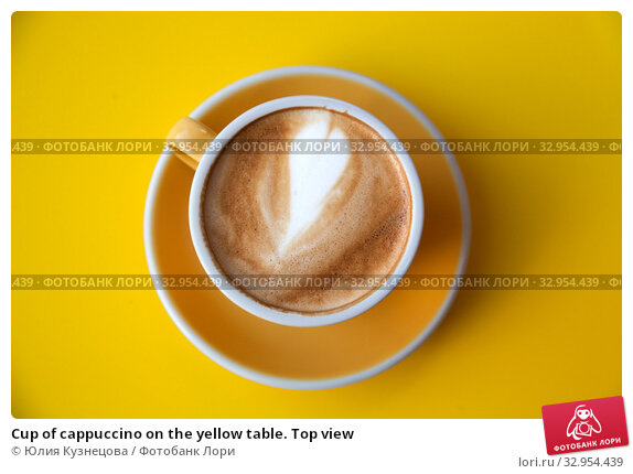 Cup of cappuccino on the yellow table. Top view. Стоковое фото, фотограф Юлия Кузнецова / Фотобанк Лори