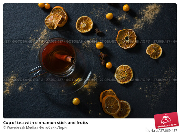 Cup of tea with cinnamon stick and fruits, фото № 27069487, снято 12 июня 2017 г. (c) Wavebreak Media / Фотобанк Лори
