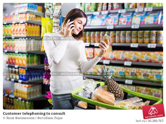 Купить «Customer telephoning to consult», фото № 30389767, снято 23 ноября 2016 г. (c) Яков Филимонов / Фотобанк Лори