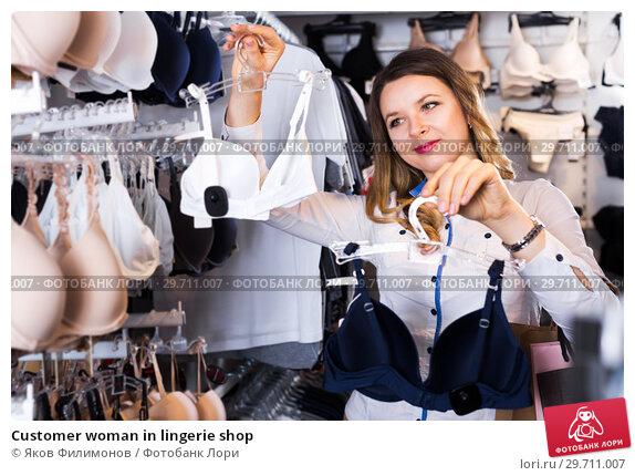 Купить «Customer woman in lingerie shop», фото № 29711007, снято 20 марта 2017 г. (c) Яков Филимонов / Фотобанк Лори