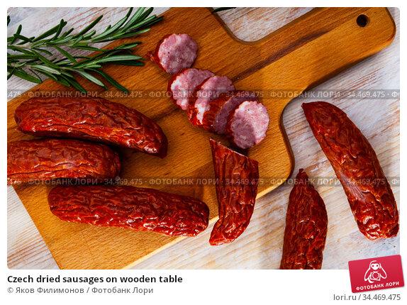 Czech dried sausages on wooden table. Стоковое фото, фотограф Яков Филимонов / Фотобанк Лори