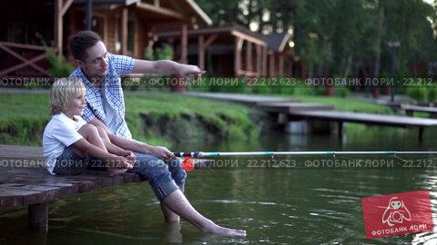 Купить «Dad and son fishing outdoors», видеоролик № 22212623, снято 14 марта 2016 г. (c) Raev Denis / Фотобанк Лори