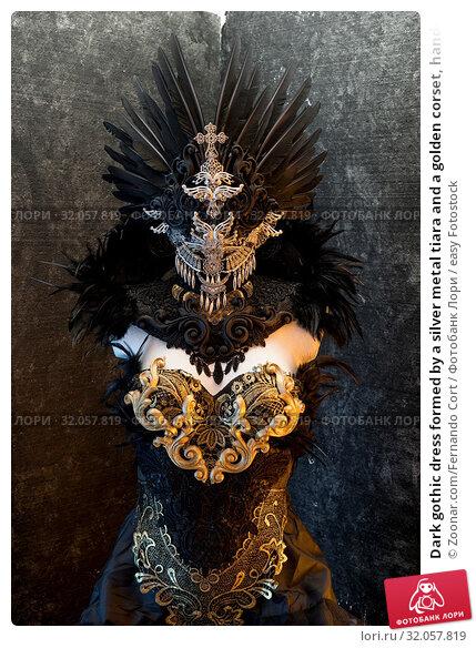 Dark gothic dress formed by a silver metal tiara and a golden corset, handmade costume. Стоковое фото, фотограф Zoonar.com/Fernando Cort / easy Fotostock / Фотобанк Лори