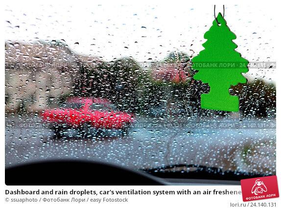 Купить «Dashboard and rain droplets, car's ventilation system with an air freshener on it», фото № 24140131, снято 26 июля 2013 г. (c) easy Fotostock / Фотобанк Лори