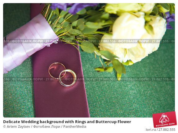 Купить «Delicate Wedding background with Rings and Buttercup Flower», фото № 27882555, снято 22 апреля 2019 г. (c) PantherMedia / Фотобанк Лори