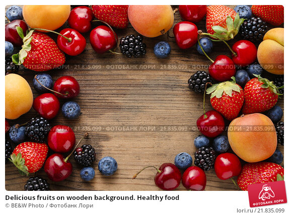 Delicious fruits on wooden background. Healthy food. Стоковое фото, агентство BE&W Photo / Фотобанк Лори
