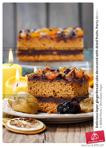 Купить «Delicious layer gingerbread cake decorated with dried fruits. Party dessert», фото № 6979127, снято 21 августа 2018 г. (c) BE&W Photo / Фотобанк Лори