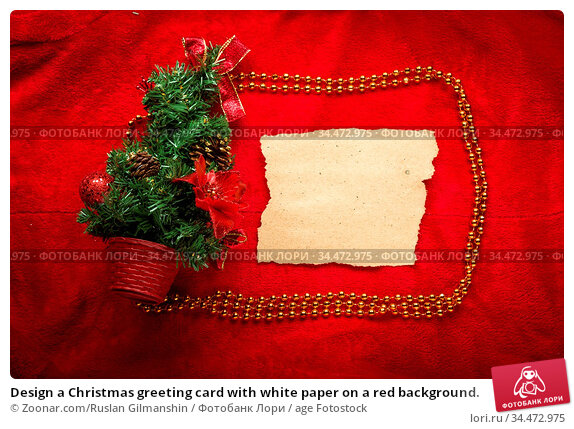 Design a Christmas greeting card with white paper on a red background. Стоковое фото, фотограф Zoonar.com/Ruslan Gilmanshin / age Fotostock / Фотобанк Лори
