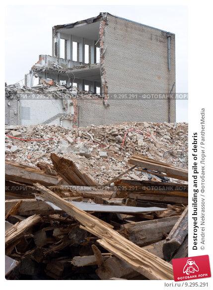 Pile Of Building Debris : Destroyed building and pile of debris Купить фото