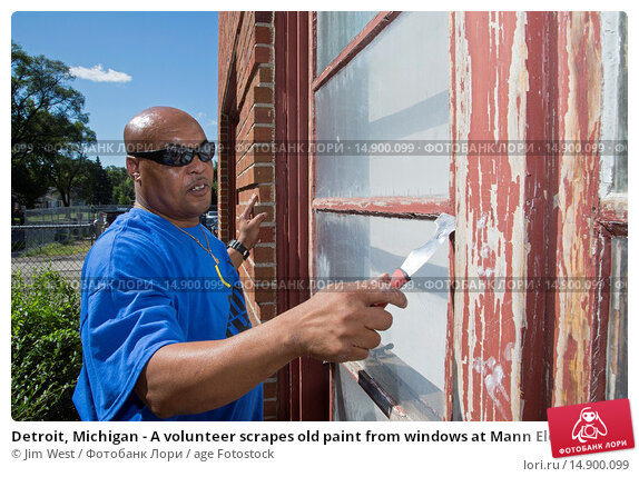 Купить «Detroit, Michigan - A volunteer scrapes old paint from windows at Mann Elementary School during a week-long community improvement initiative called Life...», фото № 14900099, снято 19 июня 2018 г. (c) age Fotostock / Фотобанк Лори