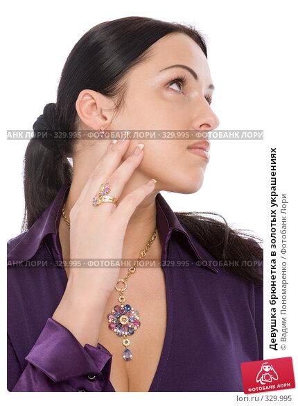 Девушка брюнетка в золотых украшениях, фото № 329995, снято 8 мая 2008 г. (c) Вадим Пономаренко / Фотобанк Лори
