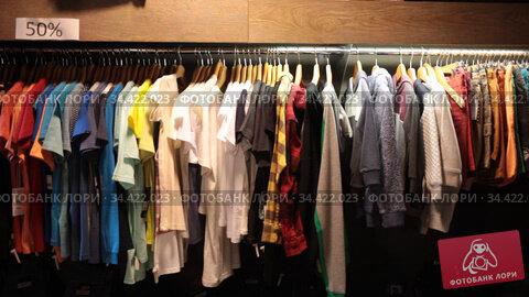 Different assortment of fashionable stylish beautiful clothing in the modern boutique. Стоковое видео, видеограф Яков Филимонов / Фотобанк Лори