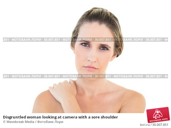 Купить «Disgruntled woman looking at camera with a sore shoulder», фото № 30007851, снято 5 июня 2013 г. (c) Wavebreak Media / Фотобанк Лори