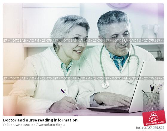 Купить «Doctor and nurse reading information», фото № 27075527, снято 11 декабря 2017 г. (c) Яков Филимонов / Фотобанк Лори
