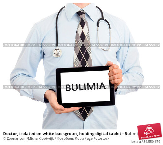 Doctor, isolated on white backgroun, holding digital tablet - Bulimia. Стоковое фото, фотограф Zoonar.com/Micha Klootwijk / age Fotostock / Фотобанк Лори